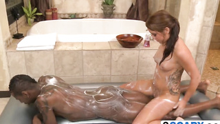 Petite girl gives a passionate soapy massage to a black cock