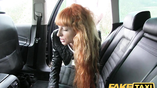 Stunning redhead takes a big cock at the backseat