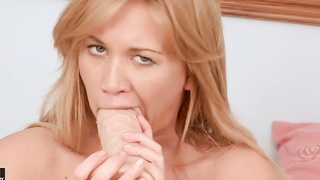 Filthy blonde Lindsey Olsen plays with a massive dildo