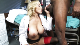 Busty blonde doctor Julia Ann sucks a big black cock